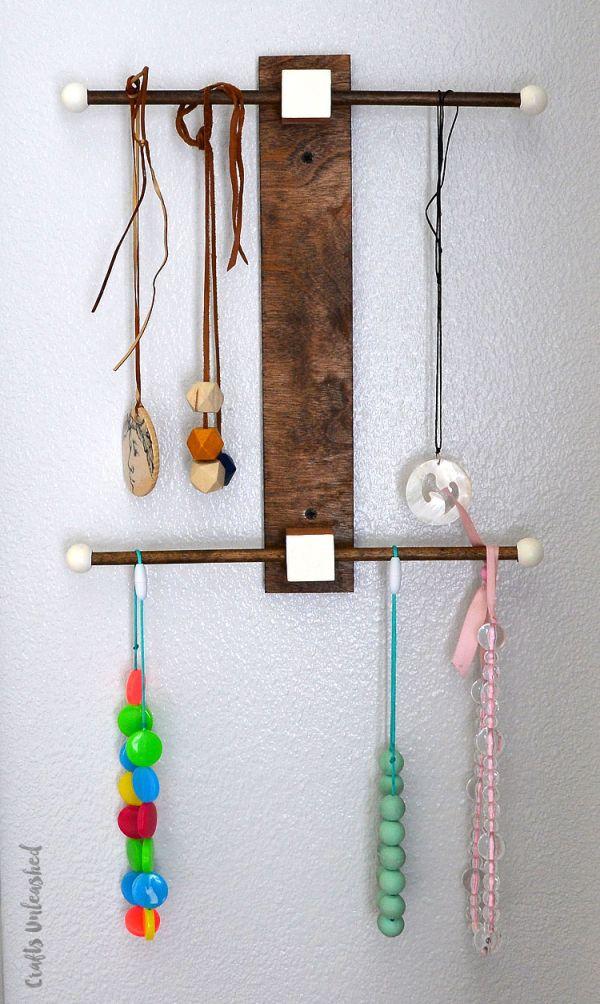 Sculptural necklace holder made of wood