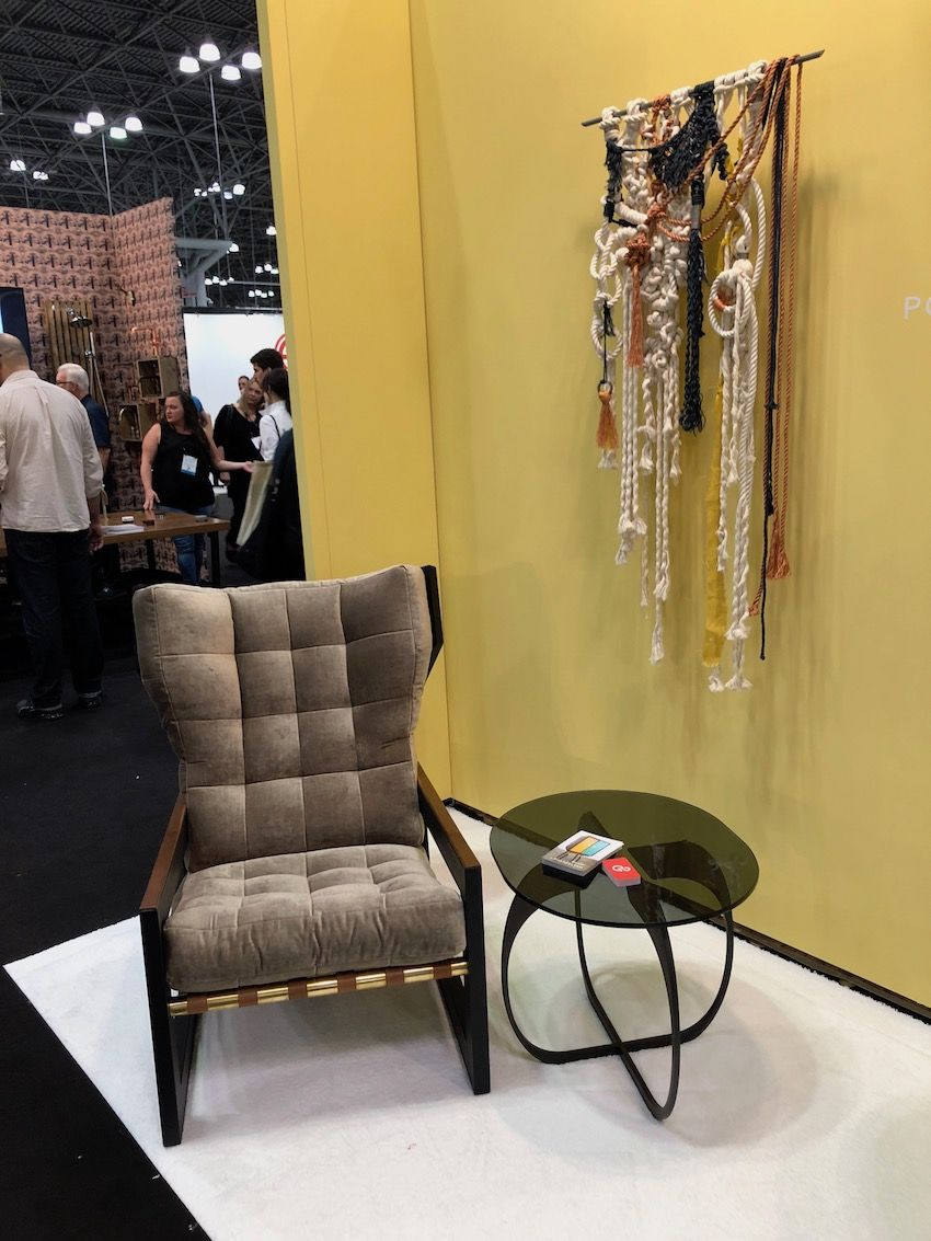 Transitional furniture, like this chair from Post and Gleam, combines traditional lines with contemporary materials.