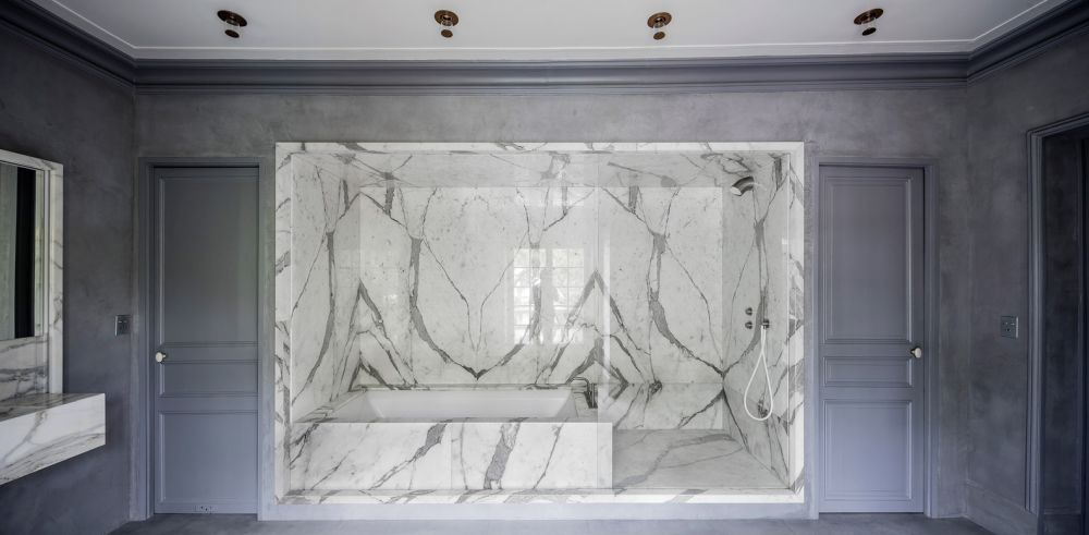 White marble was used in the bathroom to create an elegant shower and bathtub nook