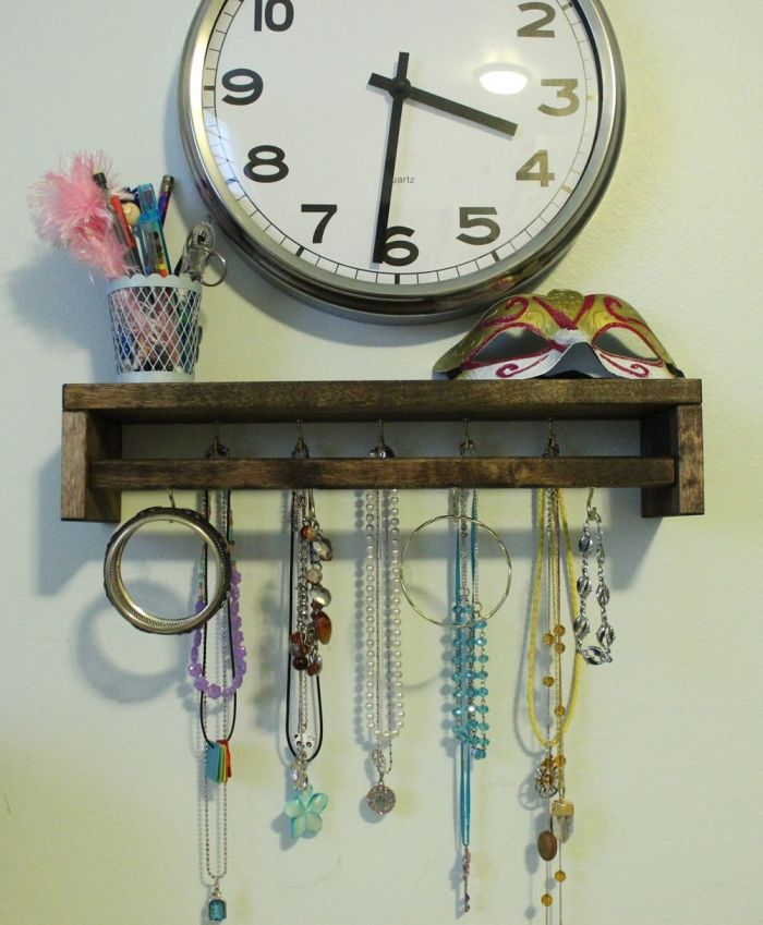Wooden spice rack repurposed into a jewelry organizer