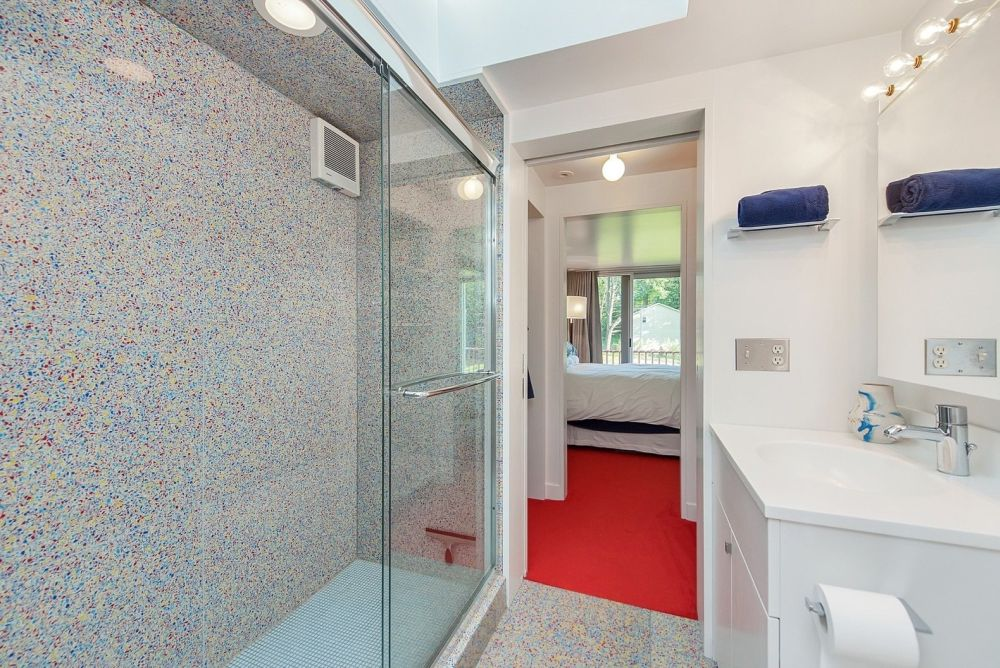 A glass walk-in shower and a skylight prevent this bathroom from looking tiny and cluttered