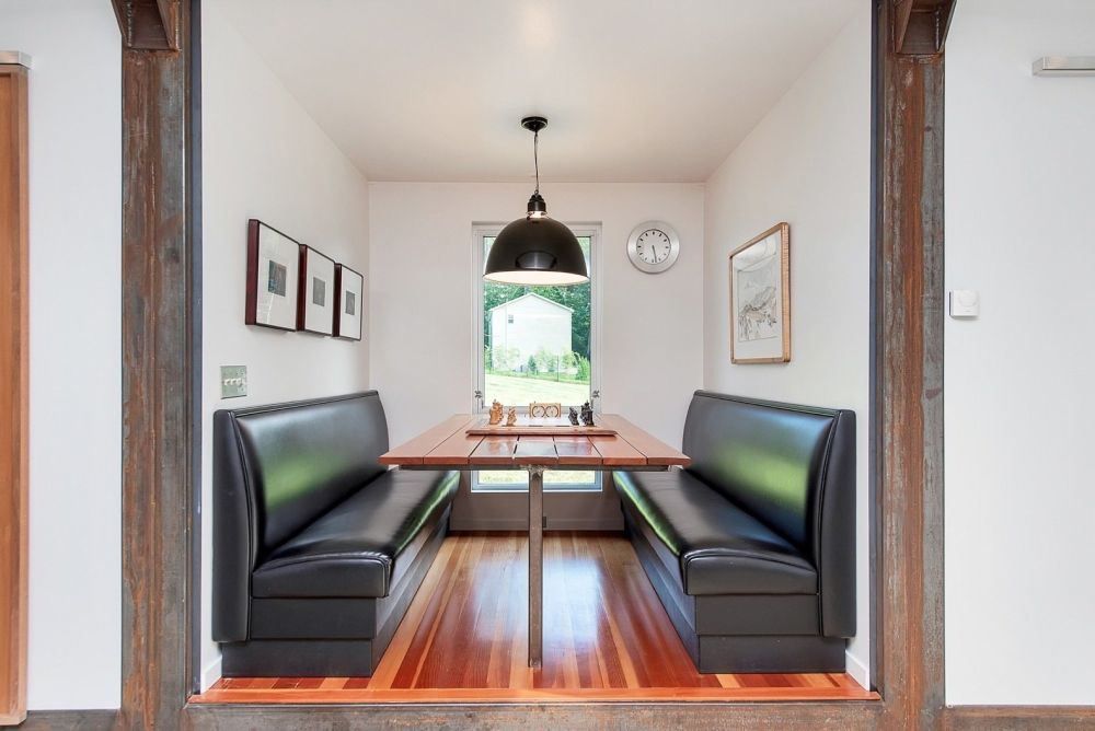 A cozy breakfast nook with banquet seating completes the social area and occupies its own little section of the floor plan