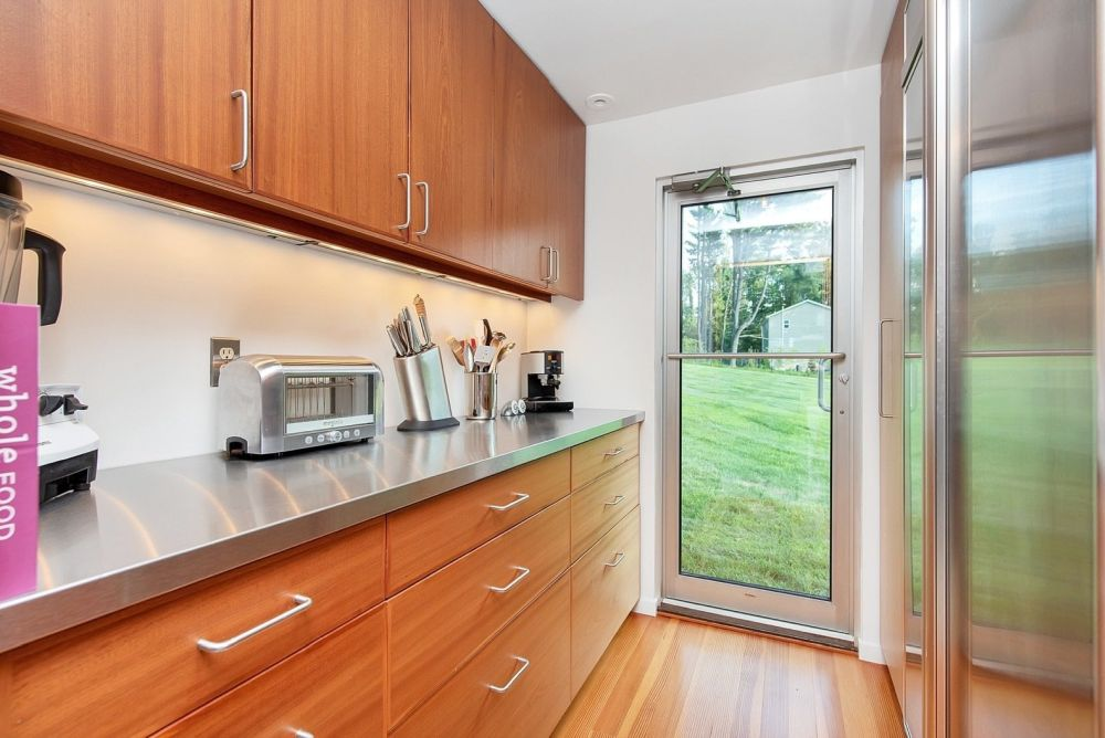 The kitchen has its own door which leads directly outside while also letting in lots of natural light