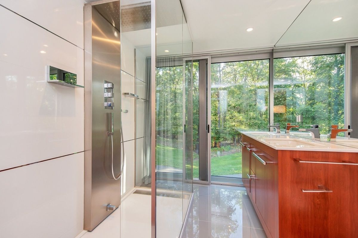 The master bathroom is even more impressive, featuring full-height windows and a very airy and bright interior