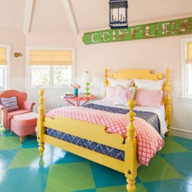 Alison Kandler bedroom interior design with yellow bed and painted furniture