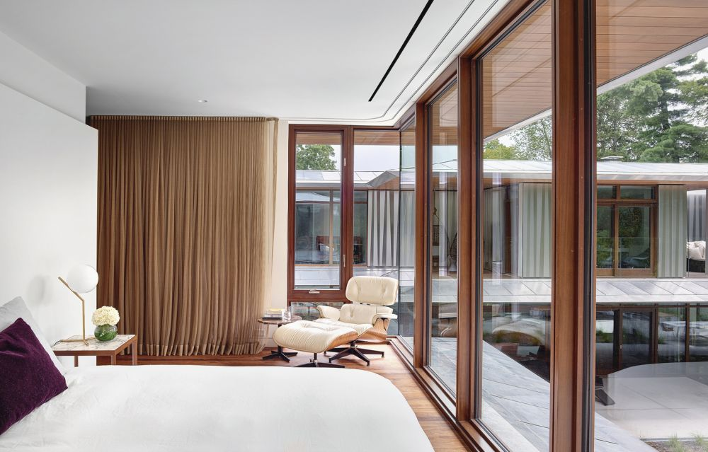 The bedrooms have full-height windows as well as long, lush curtains able to provide privacy when needed