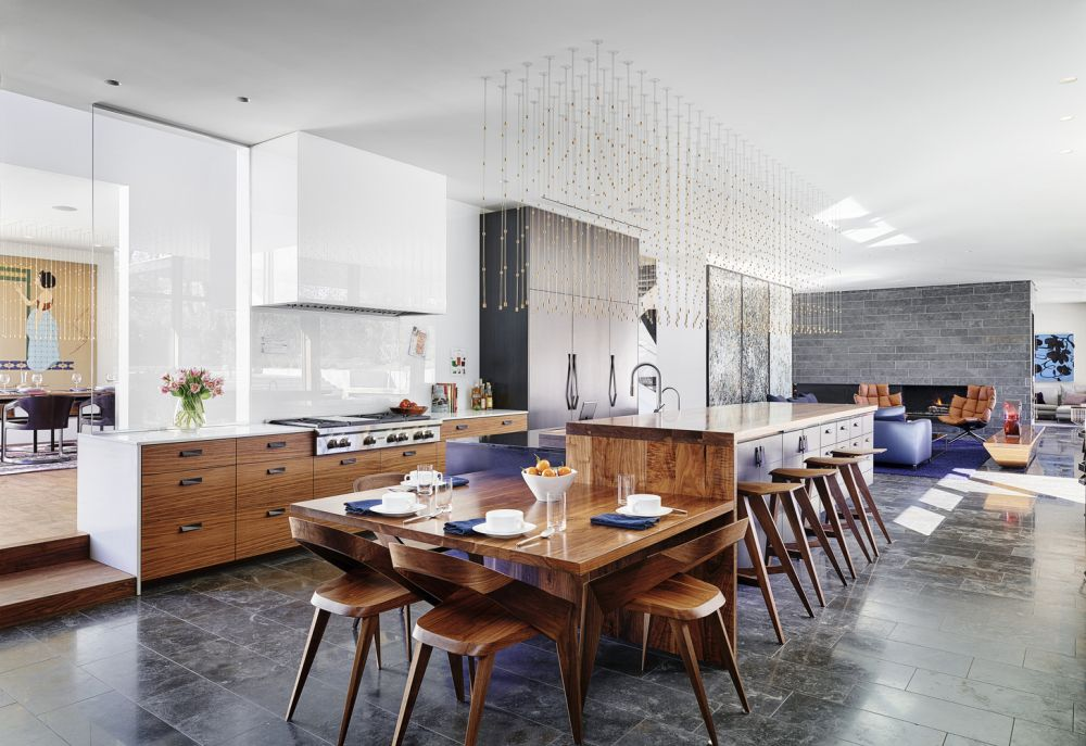 The kitchen, dining area and living space are all connected, forming a large open space