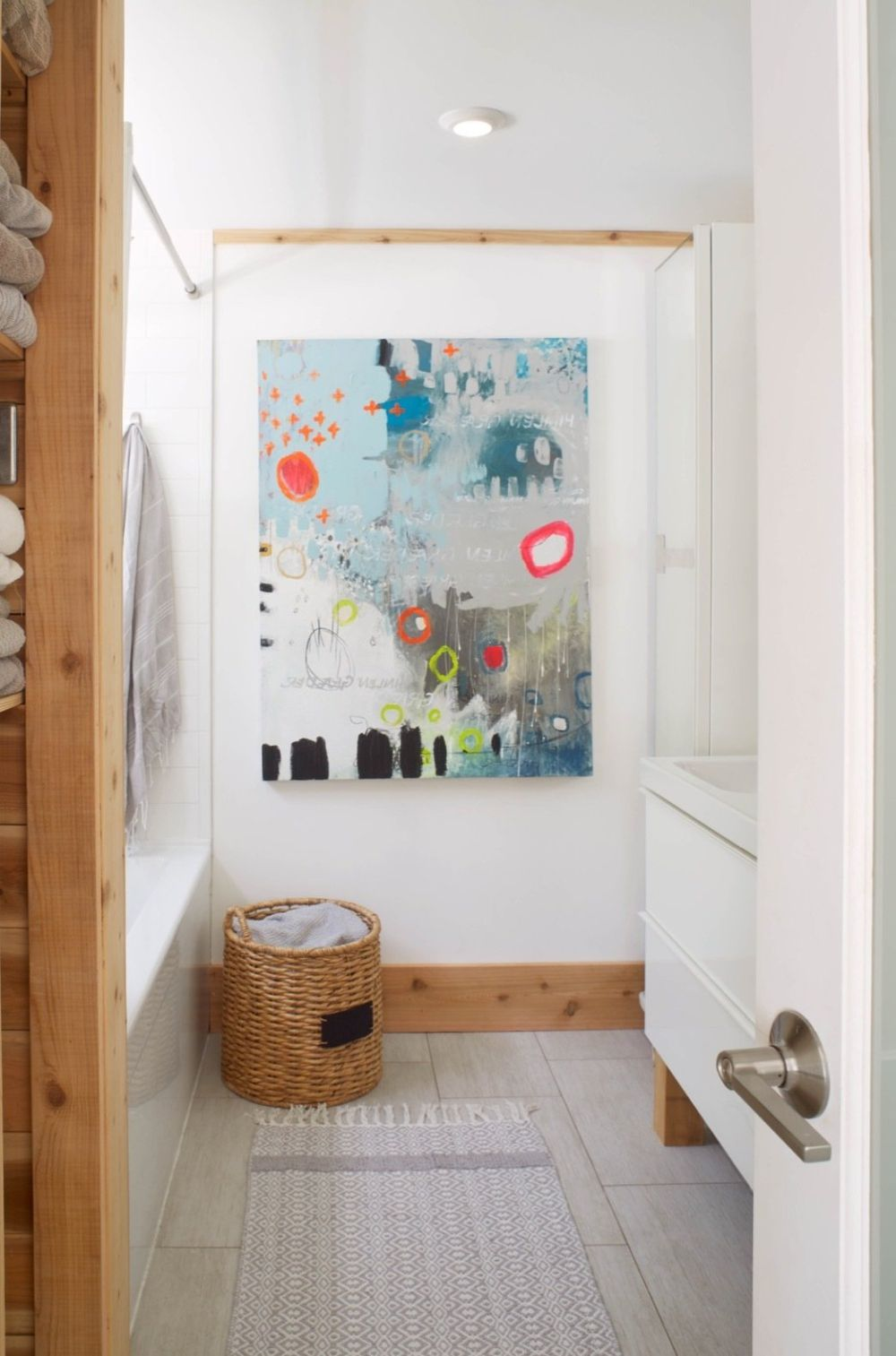 The same simple, Scandinavian-inspired decor was used in all the spaces, including the bathroom