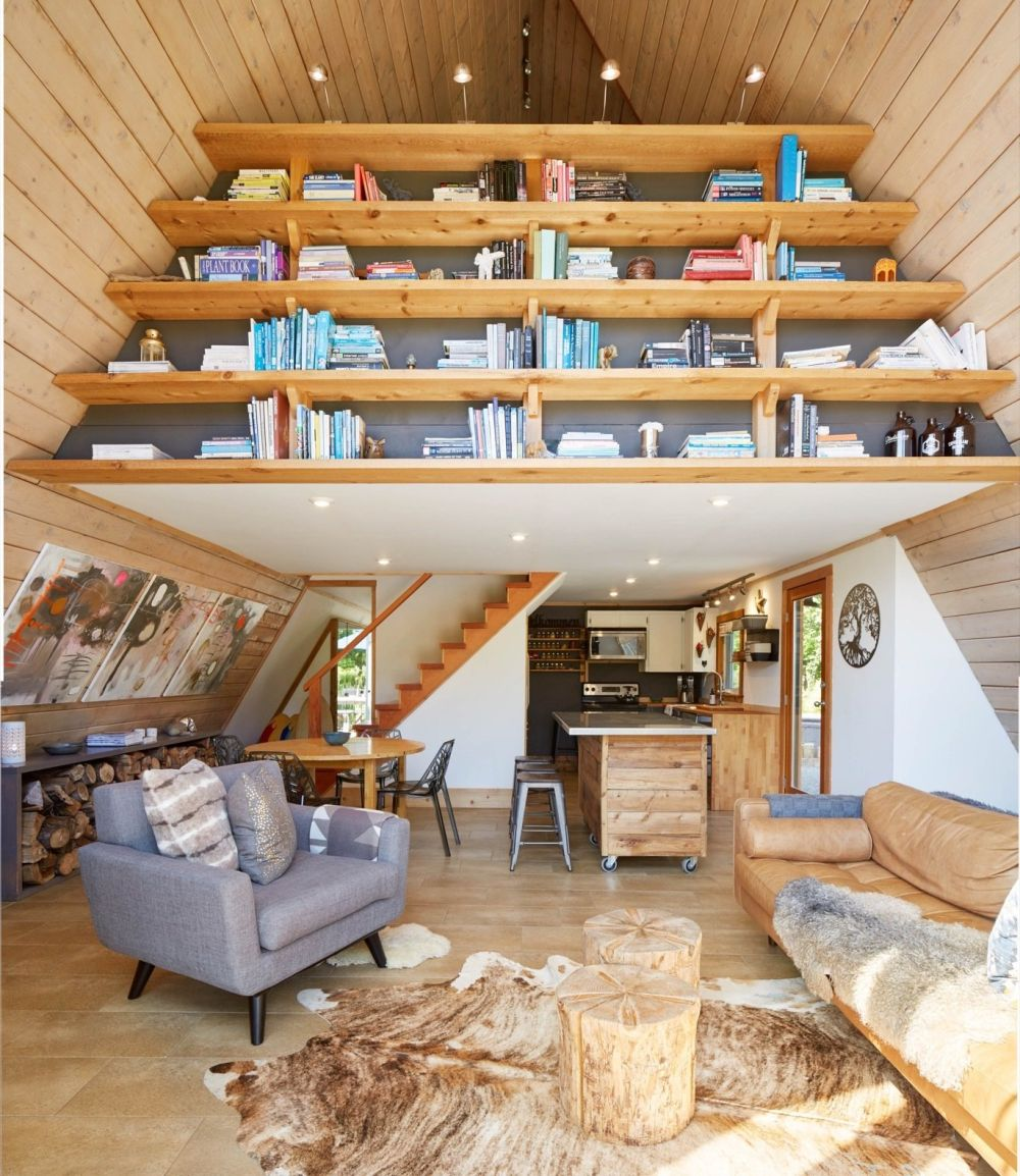 The interior is organized on two floors, the upstairs featuring a custom shelving unit which doubles as a divider