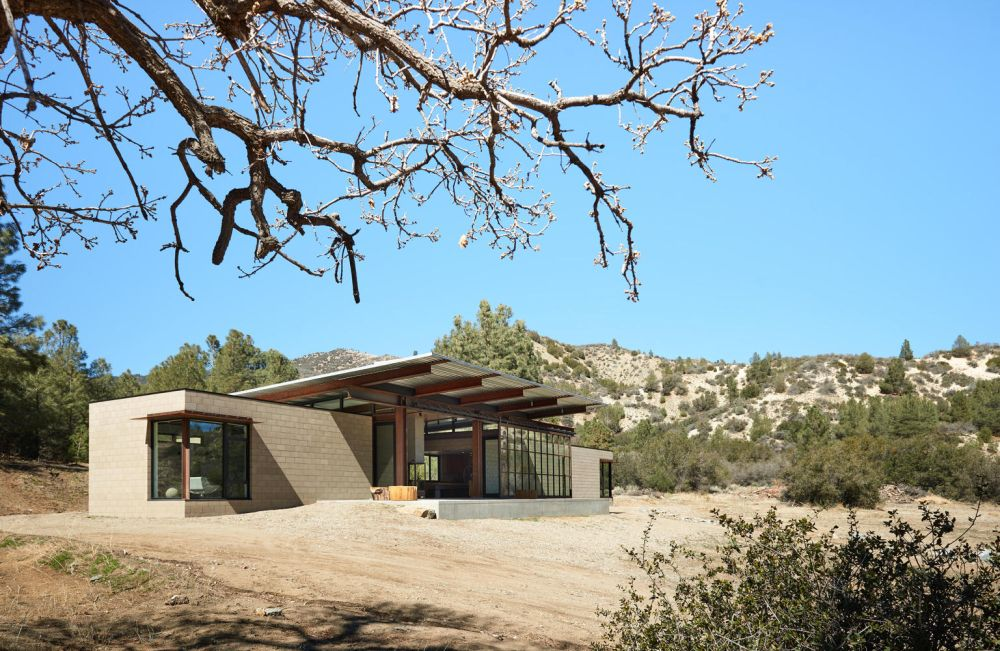 The desert landscape and harsh climate inspired the architects to use durable materials throughout the project