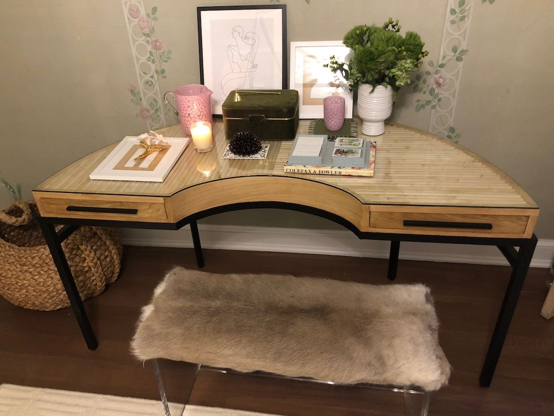 A unique half-circle desk from CB2 can be a dressing table or a writing table.