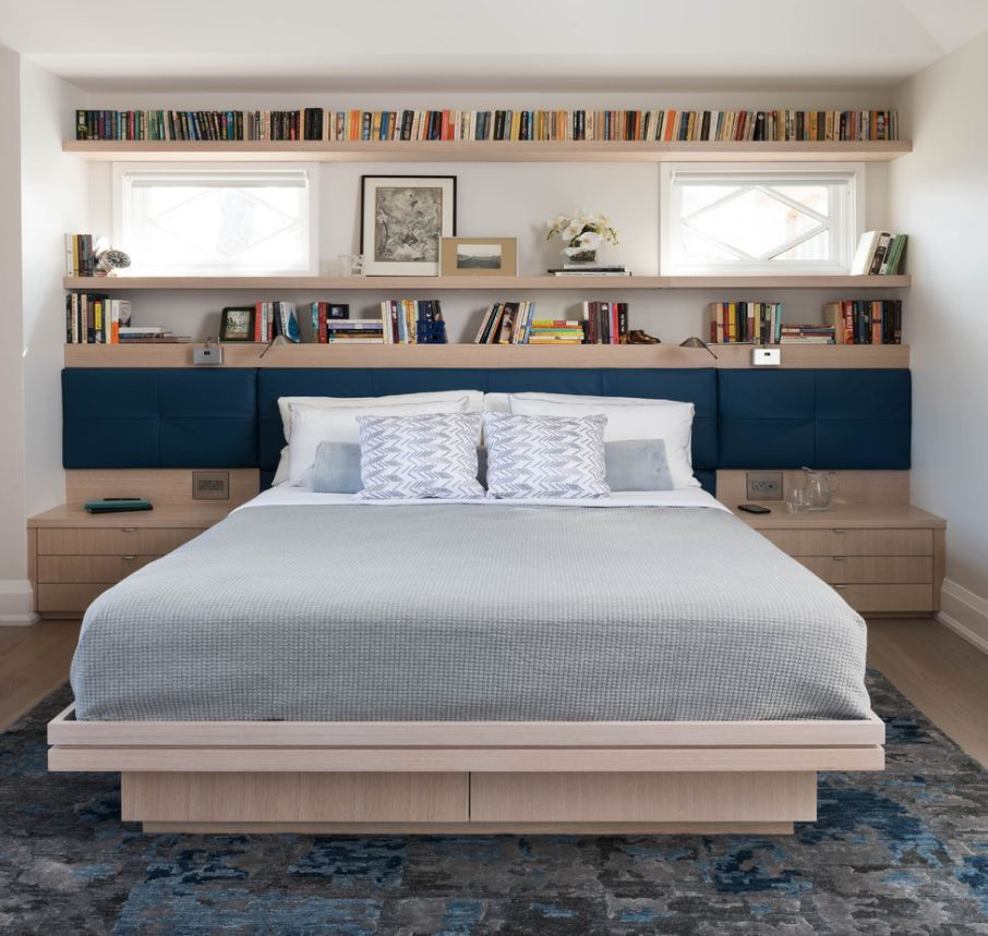 A bookcakse headboard is super functional.
