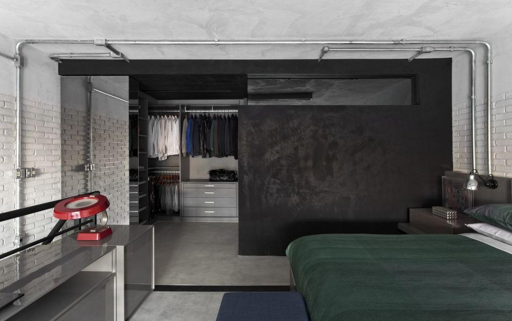The bedroom has a large walk-in closet/ dressing room with plenty of storage space