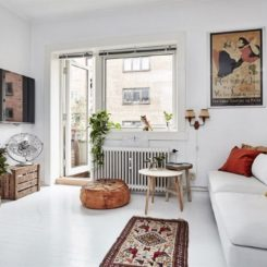 Clean white scandinavian small living roomm