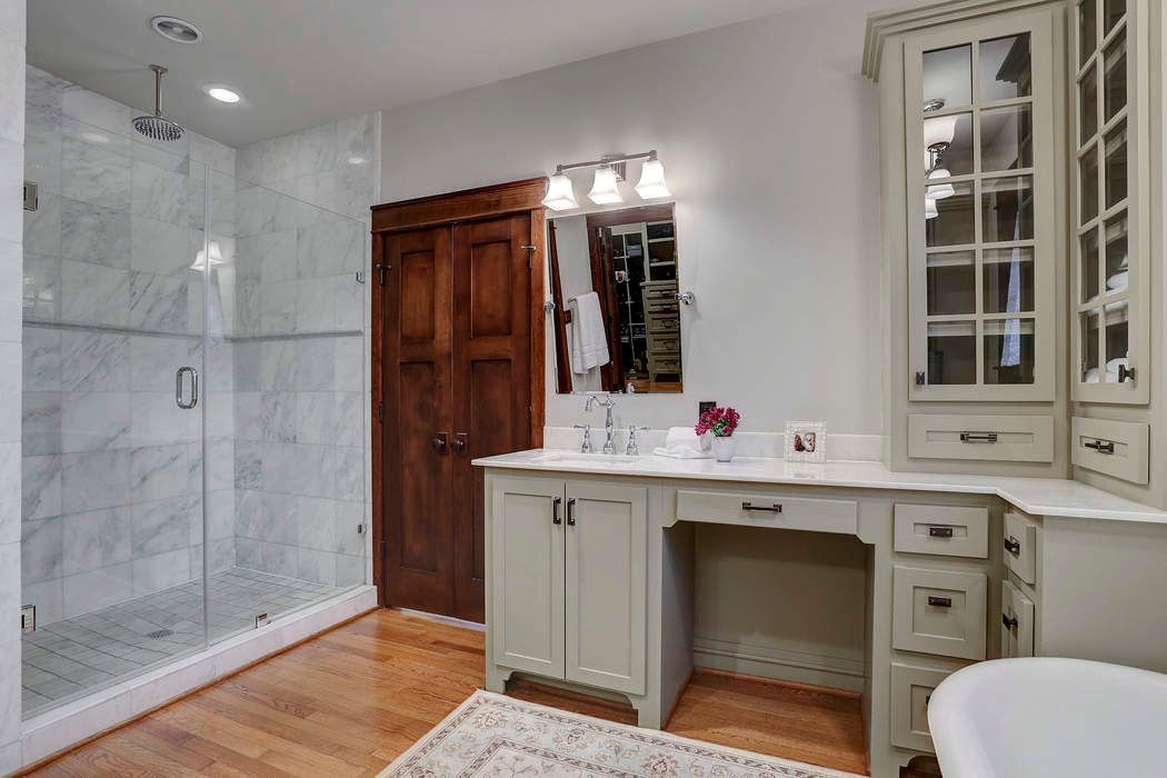 The full glass walk-in shower is one of the features which update the house's overall appearance, giving it a modern feel