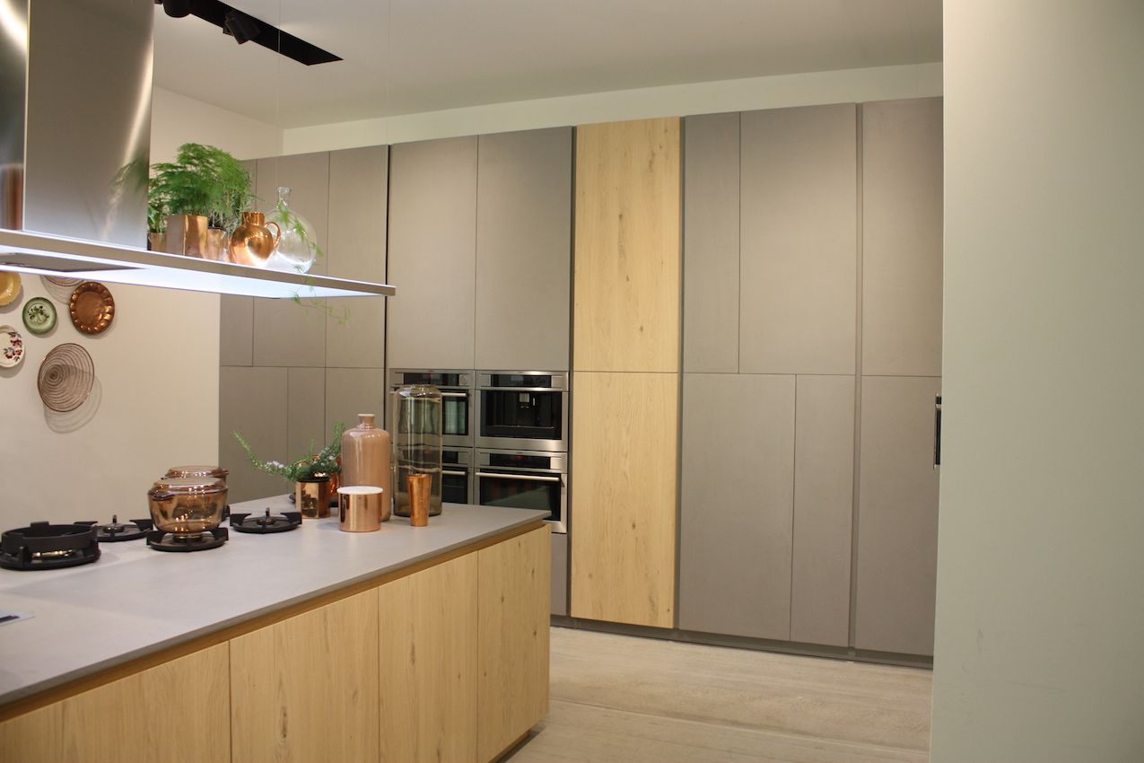 This Dolmi kitchen hides its workings behind handle-less cabinets.