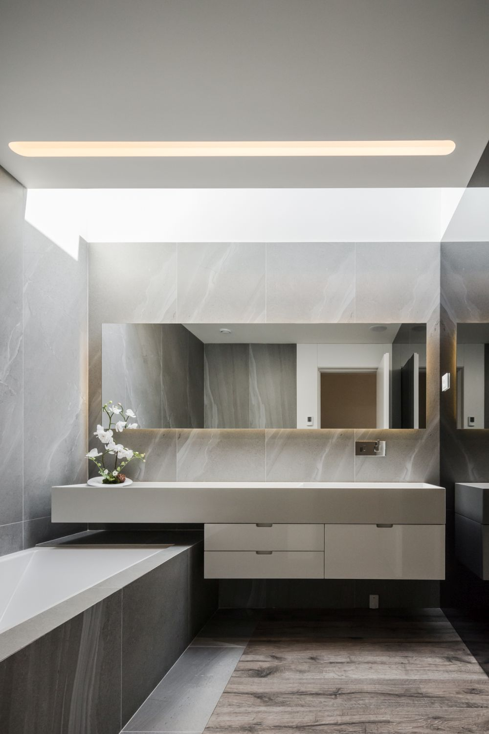 There's no shortage of natural lighting, not even in the bathrooms where skylights open up the decor