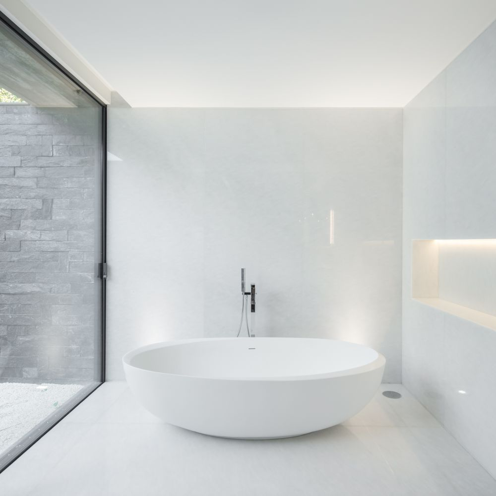 Instead of a skylight, this bathroom section features a full-height window which brings the outdoors in