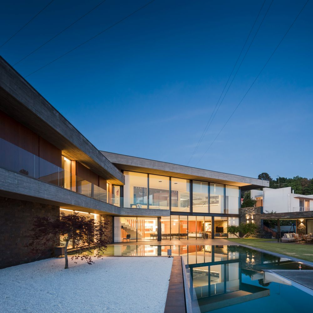 The interior courtyard is quite large, big enough to include the pool, a deck, a lounge area and a garden