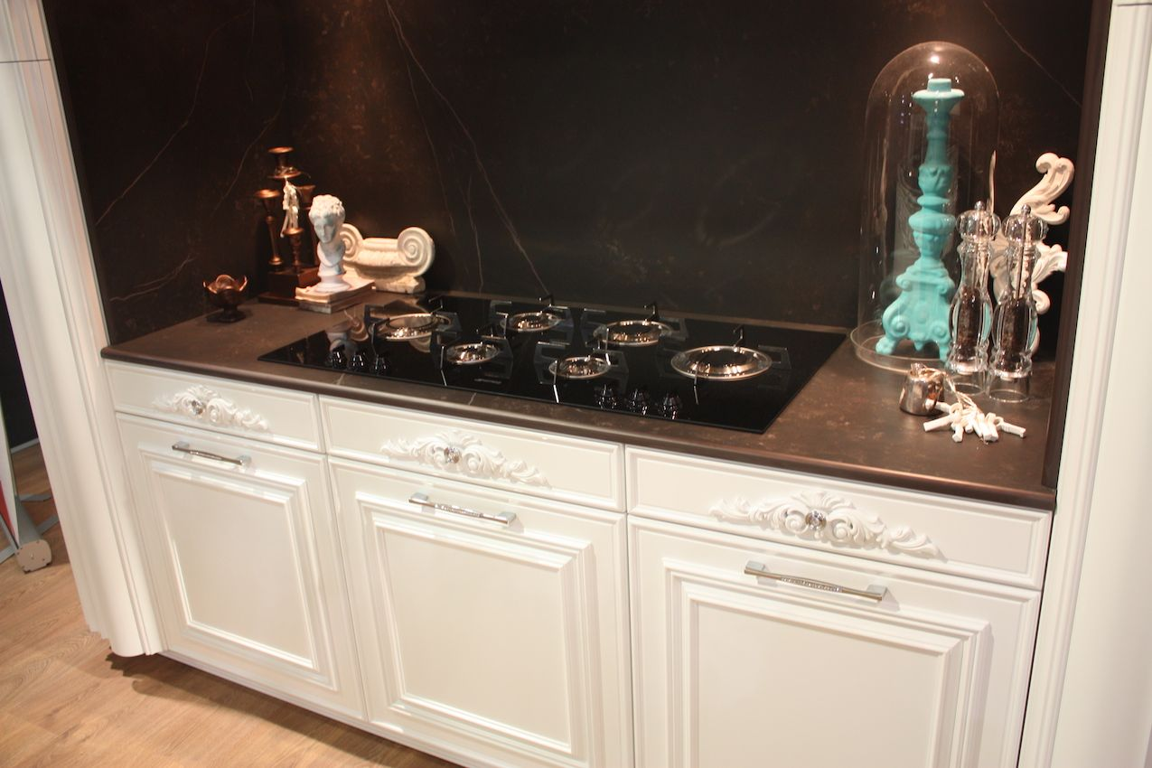 Backplates can be very ornate and add oomph to a smaller knob as in this Gatto kitchen.