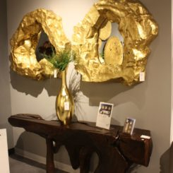 Glam mirror frames on the entryway above console