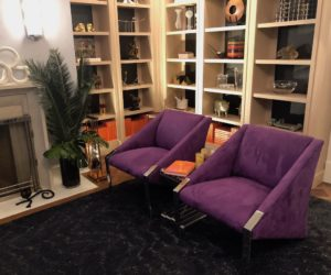 A small conversation area in the game room lets guests step away from the action for a chat.