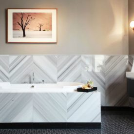 SOG Interiors Bathroom with Chevorn marble tiles