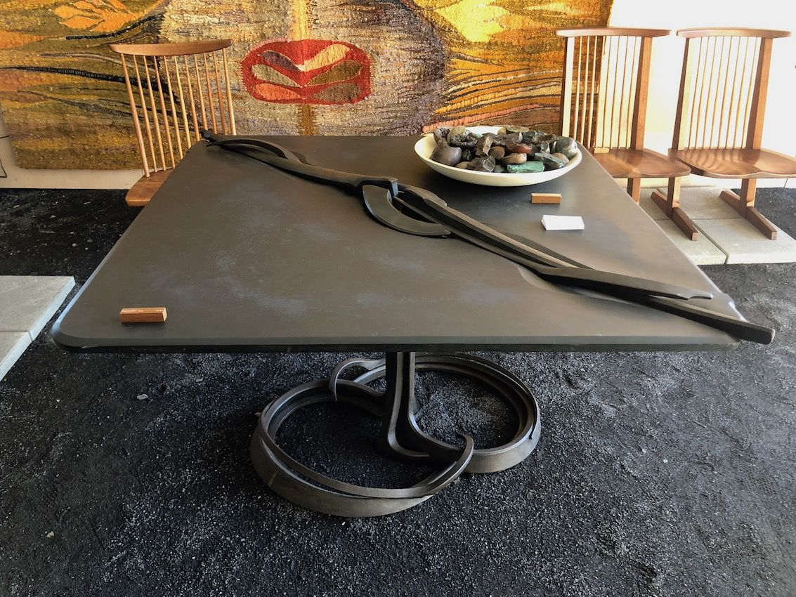 Stone and steel make a hefty table that will be the focal point of a space.
