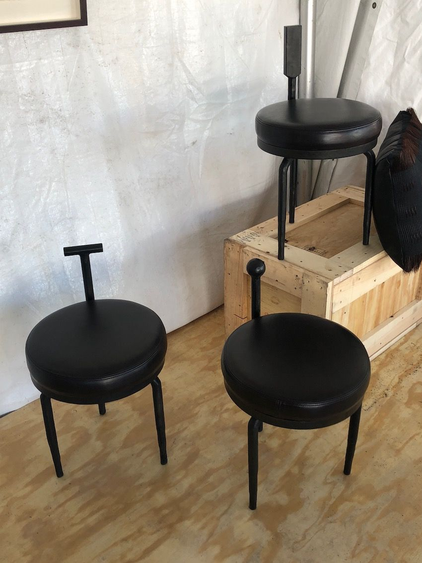 Useful stools with an edgy look are good additions for a modern space.