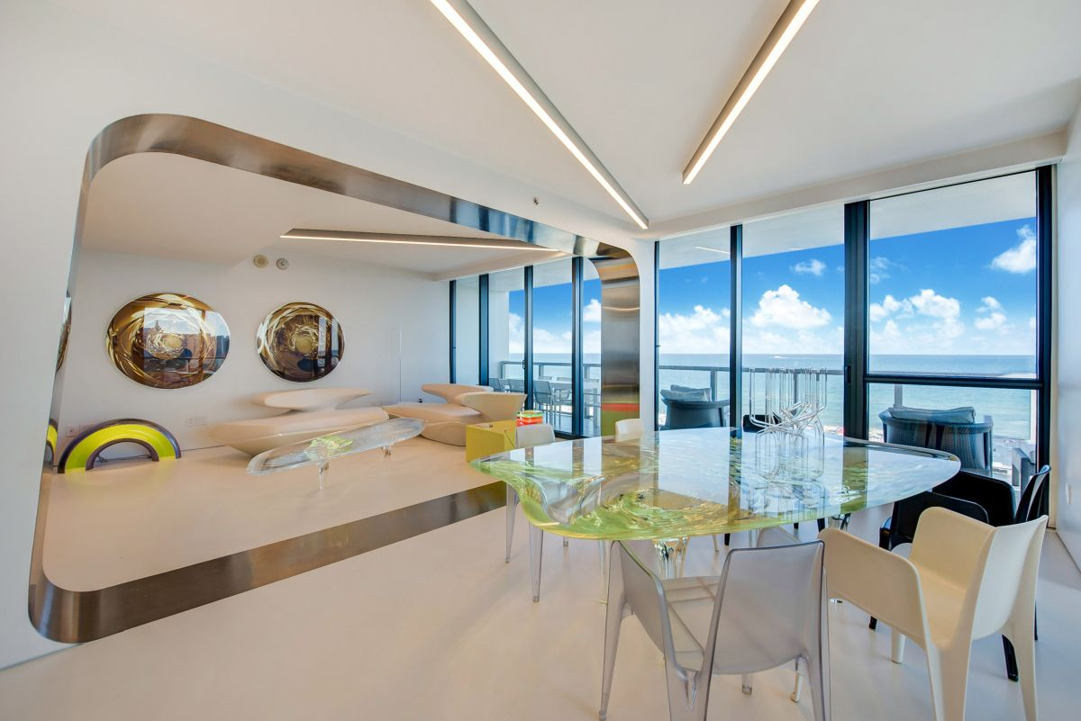 The apartment features a large, open plan social area with panoramic views of the Atlantic Ocean