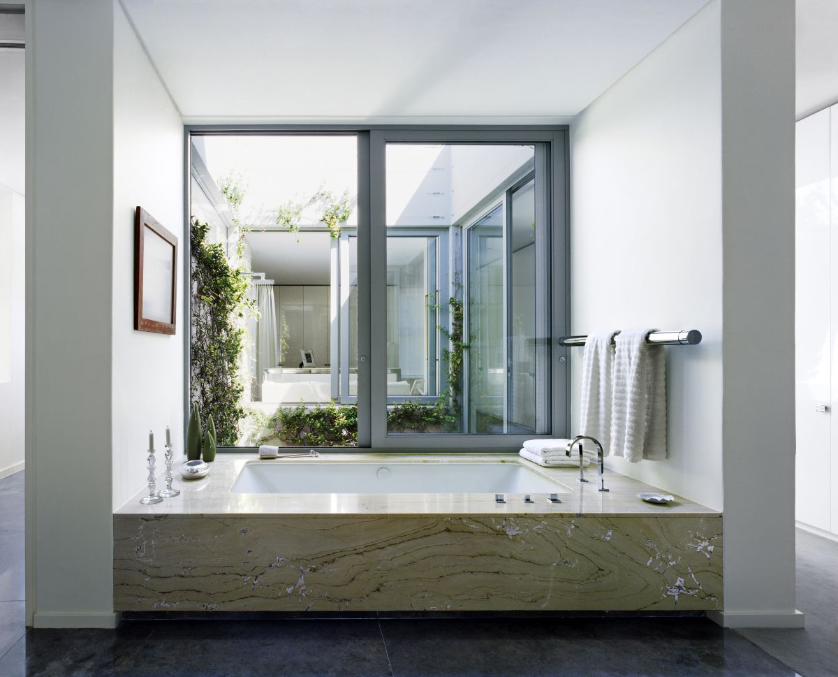 By bringing plants and greenery inside the house, the designers brought the indoor and outdoor closer together