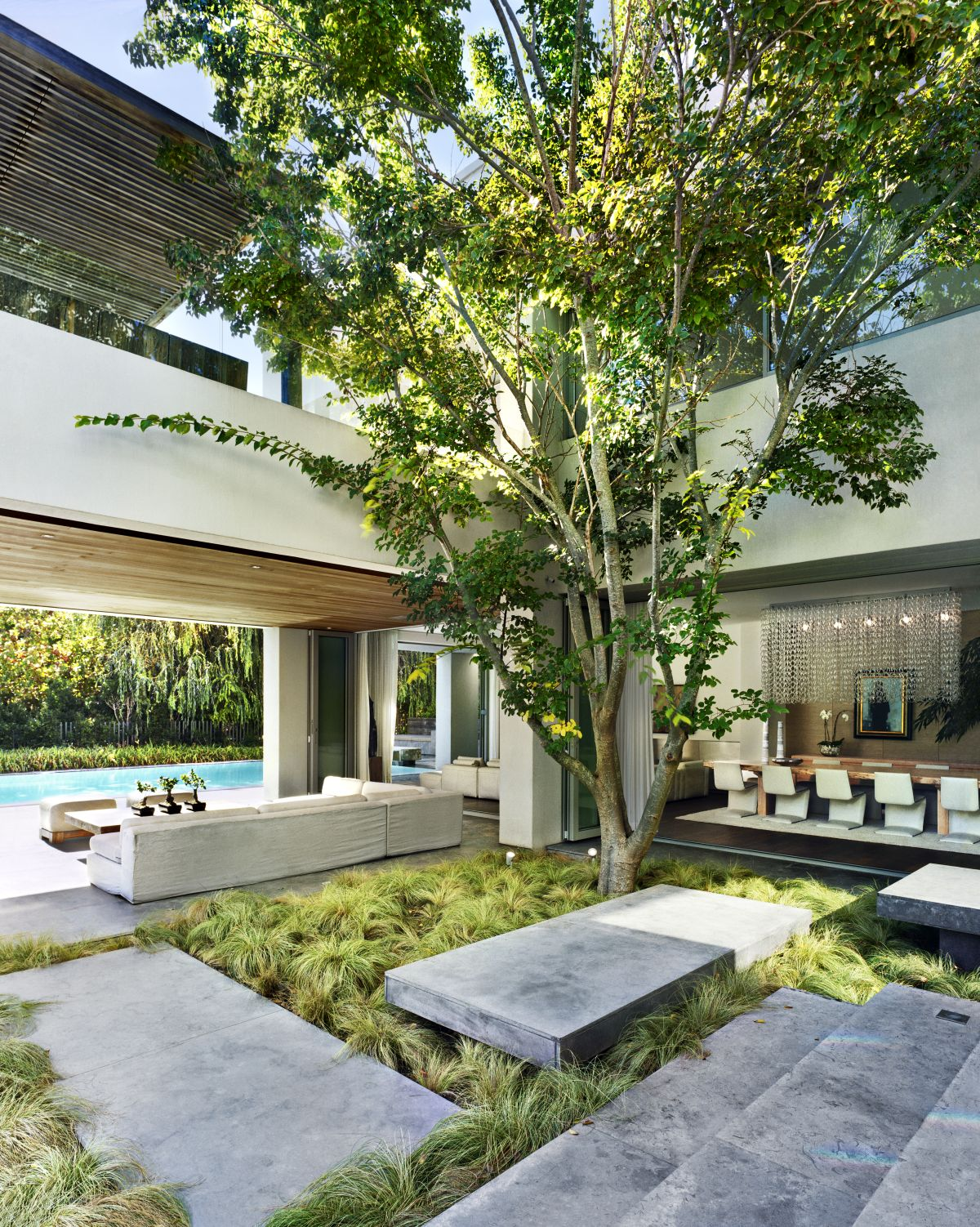 A large tree emphasizes the close connection between the house and its immediate surroundings