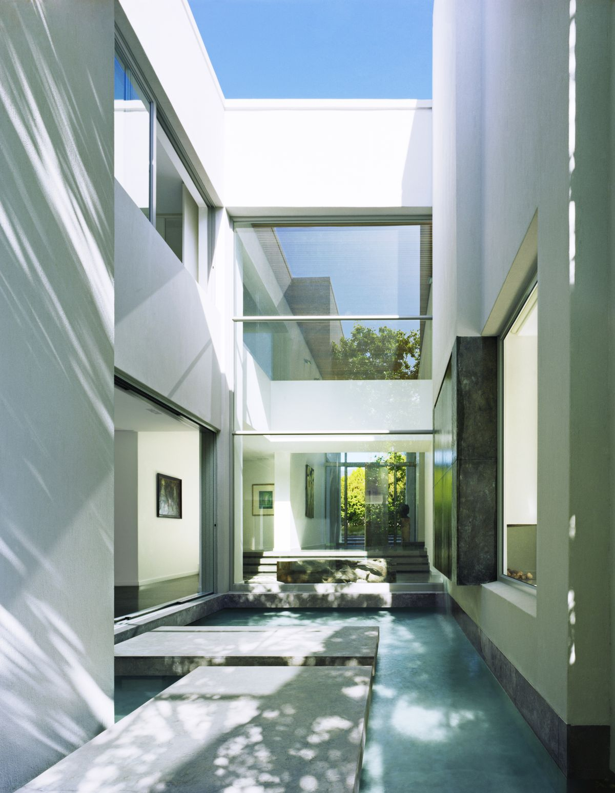 Honed stone floors and wall slabs makes the indoor-outdoor transition seamless