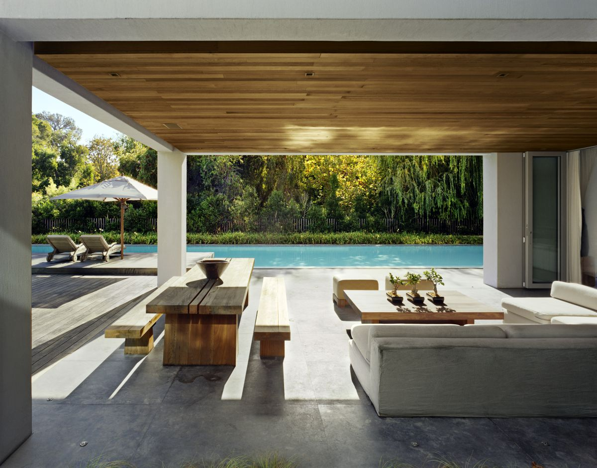 The covered patio looks and feels like an extension of the living area and serves as a secondary lounge and dining space