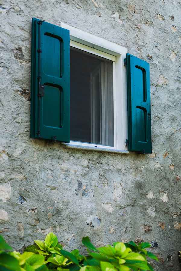 Accent The Exterior Of Your Home With Peacock Blue Shutters
