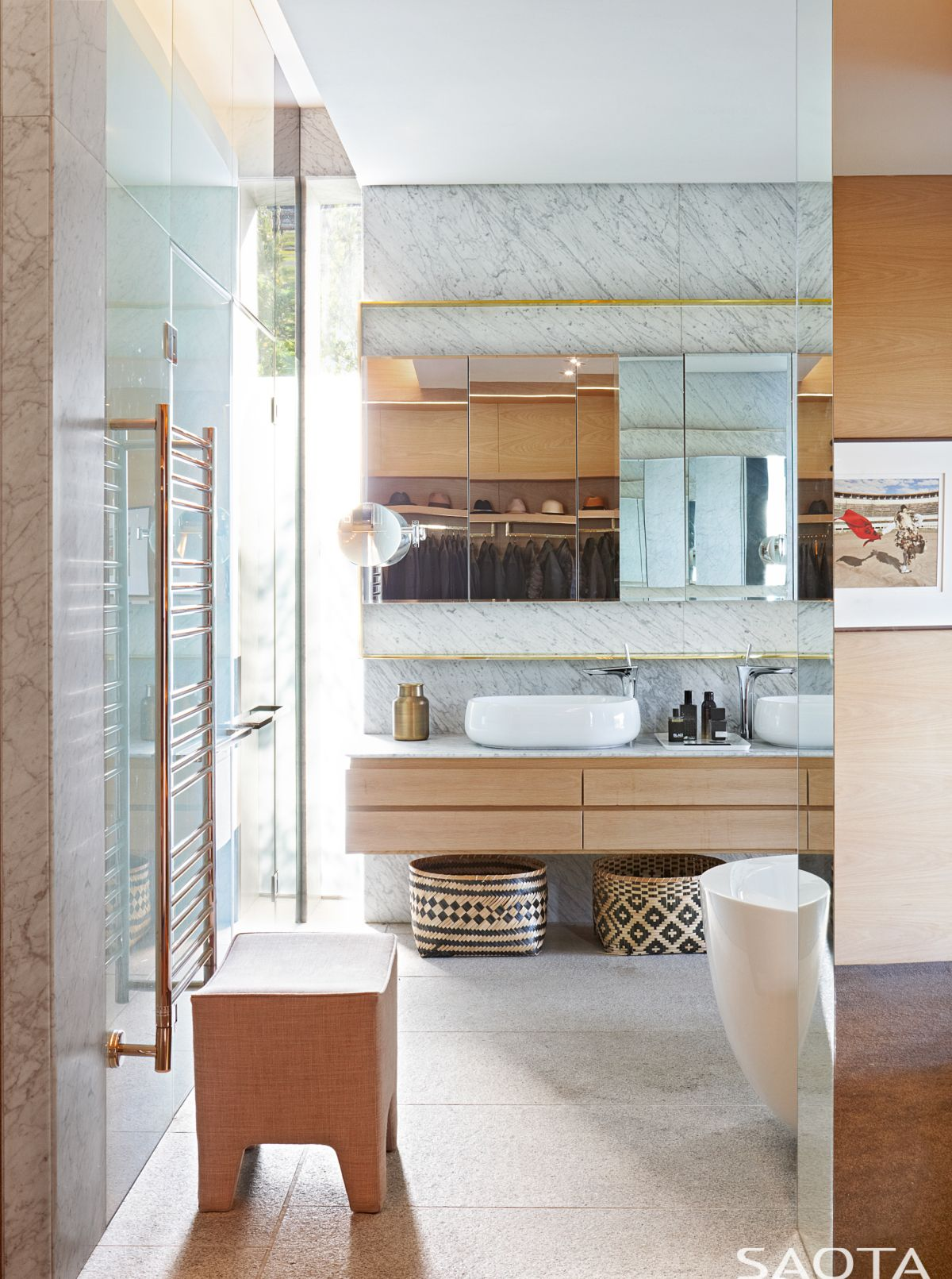 The bathrooms are as stylish as the rest of the house, featuring white marble walls and glass enclosures