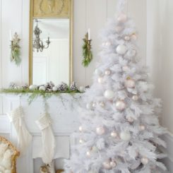 Beautiful White Christmas Tree closer to the Fireplace