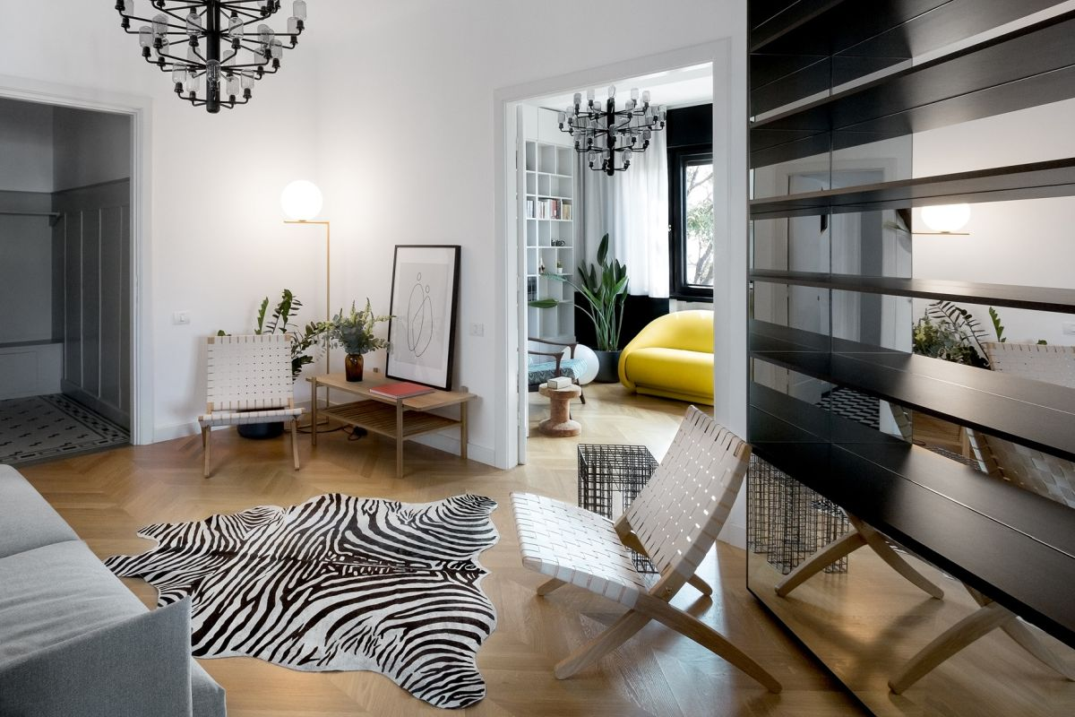 The living room has a very cozy and welcoming vibe and features a zebra rug at the center