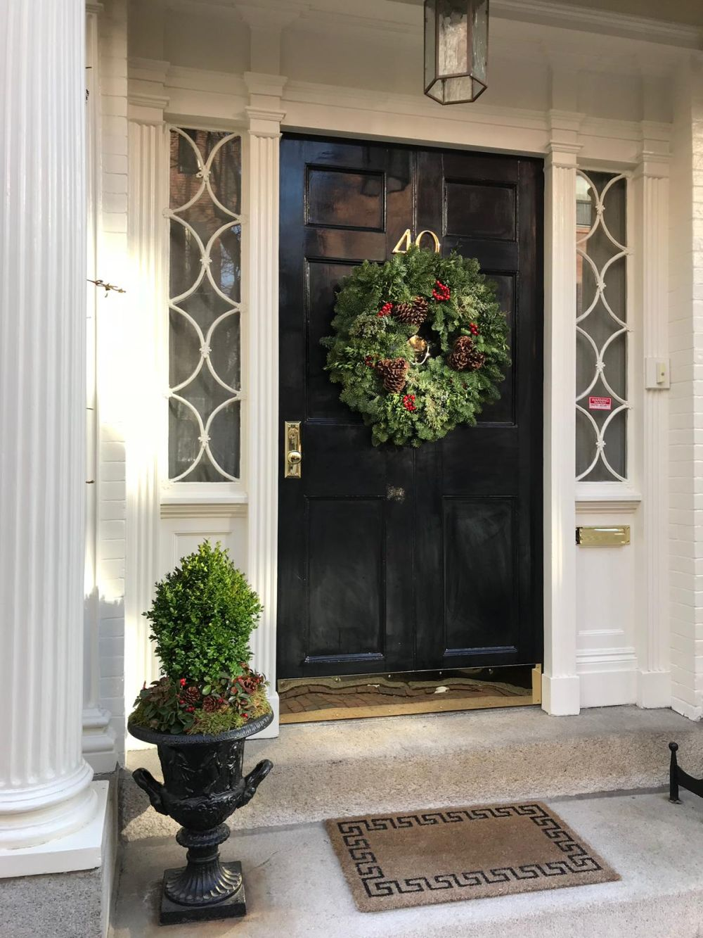 You can decorate your front door wreath with pinecones, berries and other nature-inspired things for an organic look