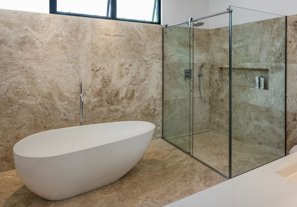 The full glass walk-in shower keeps the bathroom looking open and spacious while the windows high on the wall maintain privacy