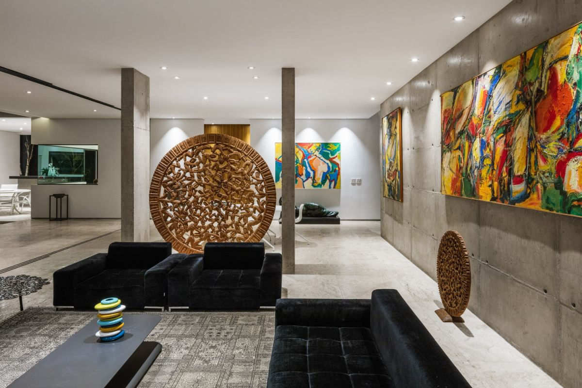 The living area is infused with colorful contemporary art pieces and eye-catching sculptures