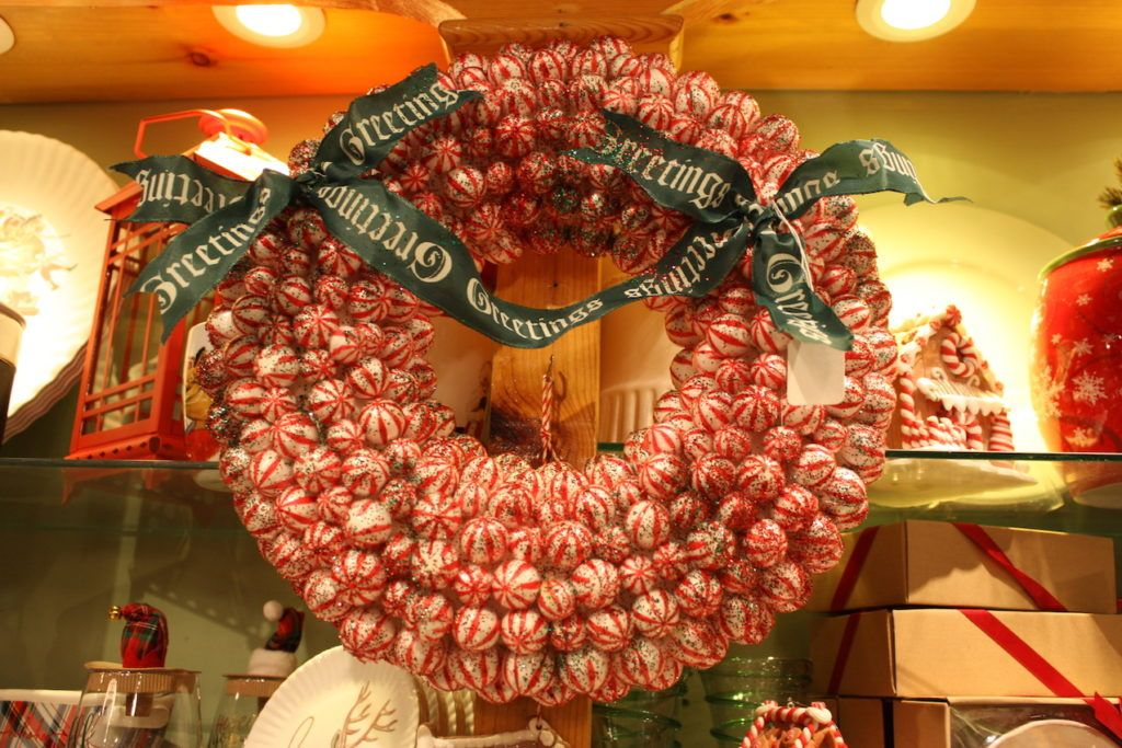 Children and adults alike will love a wreath made of candy-cane striped balls.
