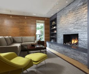 Modern living room with fireplace and accent chartreuse chair