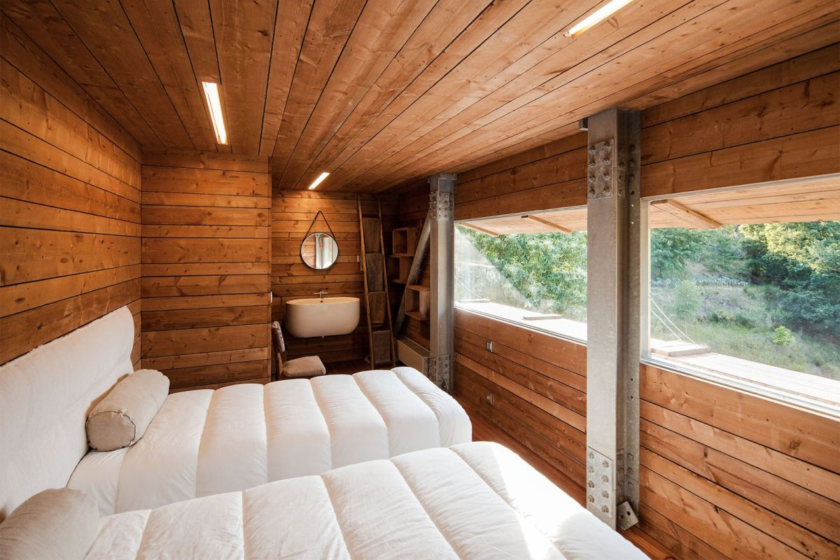 The guest bedroom is framed in wood entirely with the exception of the windows