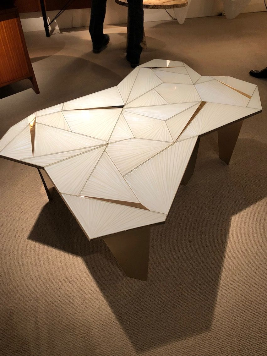 The glass and irregular shapes come together in an very intriguing table.