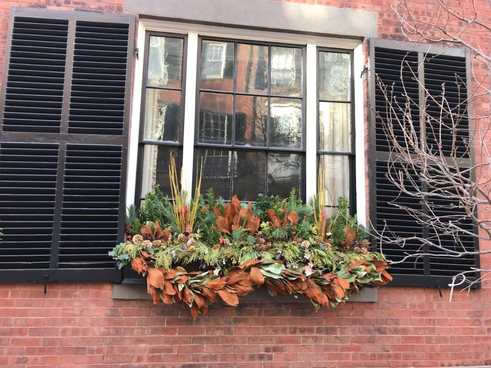 You can even hang wreaths outside your window. Just make sure you secure them porperly