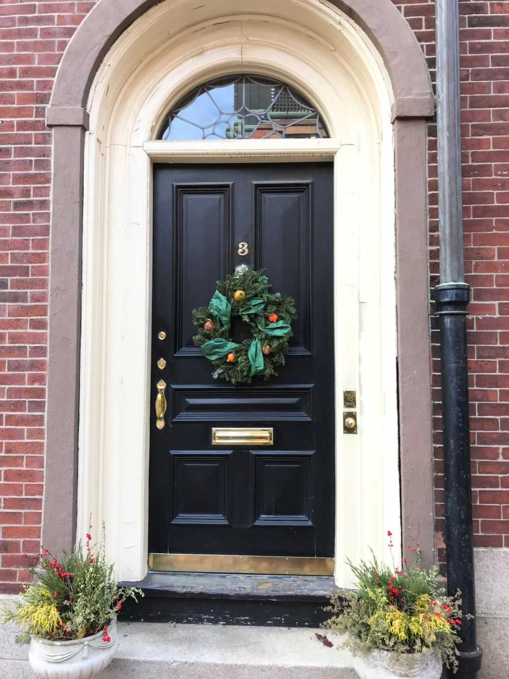 Keep the design of the wreath traditional for a more cozy and welcoming look