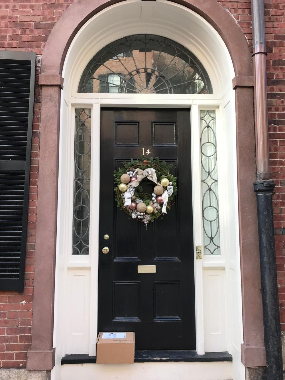 Since its Christmas you could decorate the wreath with a few ornaments that your tree could do without
