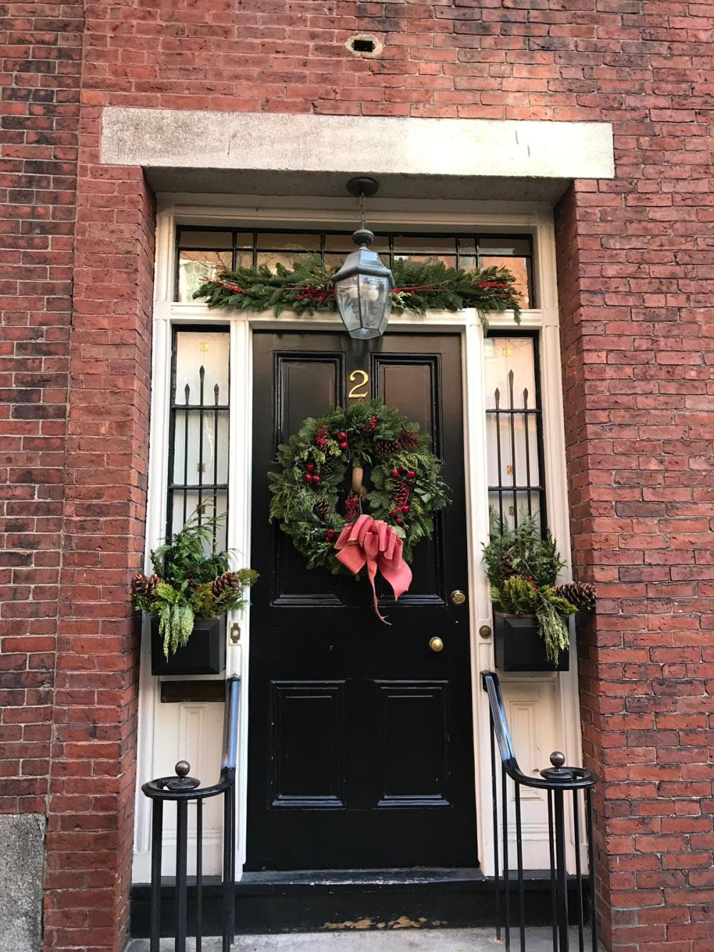 If the setup allows it, you can decorate your front door with more than just a wreath