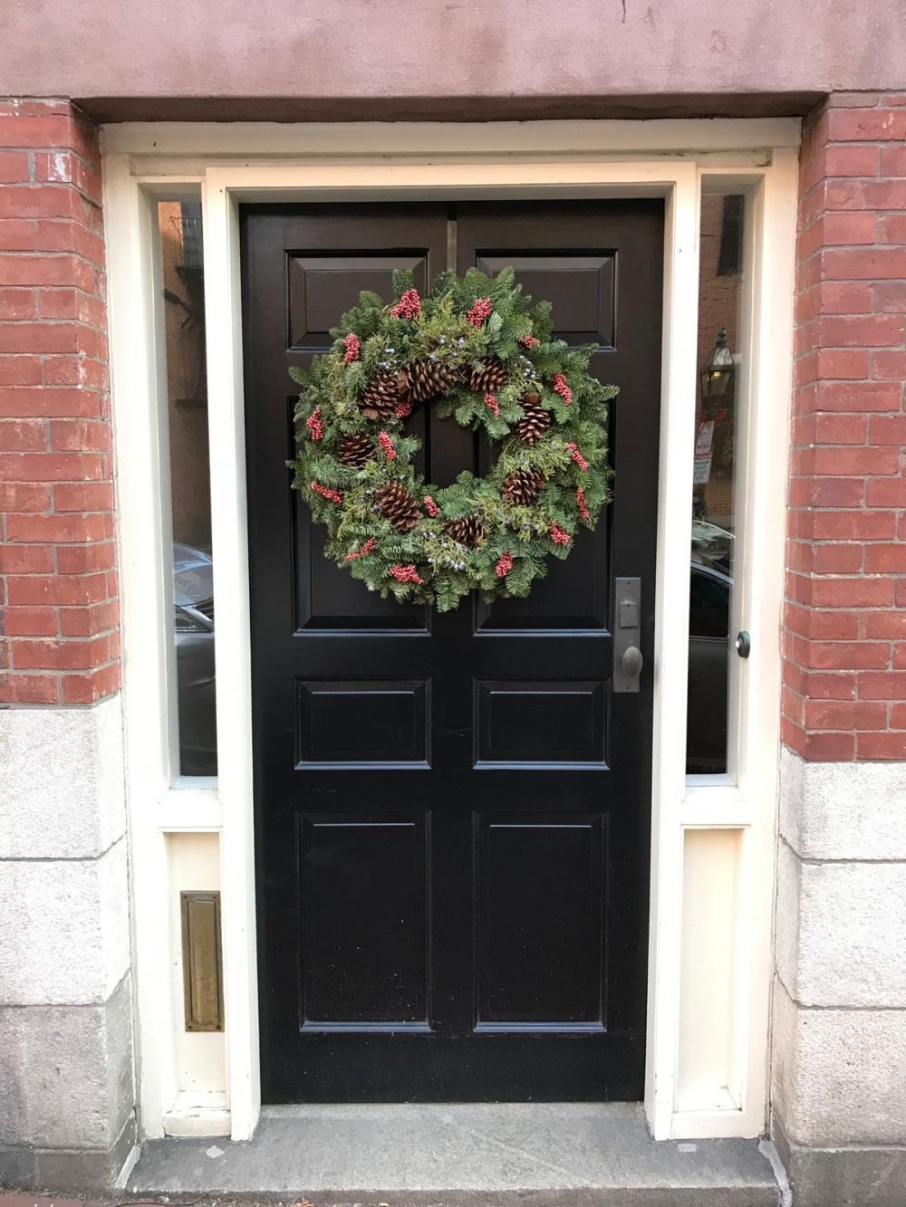 What's nice about a Christmas wreath is that you don't have to overthink it. The simple ones are plenty charming